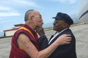 The real Dalai Lama and Desmond Tutu in an intimate moment of friendship.